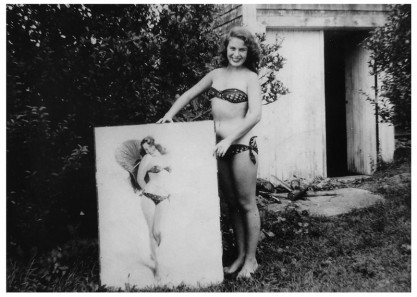 "Vera Bogach, model, posing with Armstrong's completed pastel ""Bikini Bound"" (1949)"