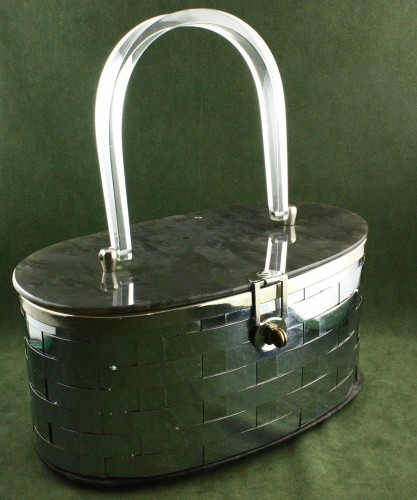 machine age 1940 lucite purse with strapped metal case