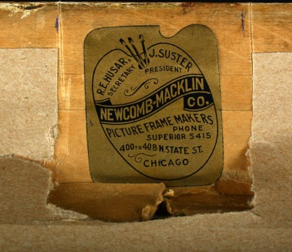 Original Newcomb-Macklin Co. label on verso