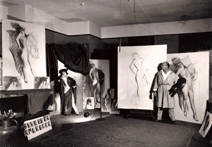 """Publicity photo of the artist Rolf Armstrong creating """"Carmen"""""""