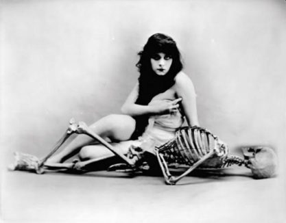 The iconic early 20th century femme fatale Theda Bara pictured nude with skeleton