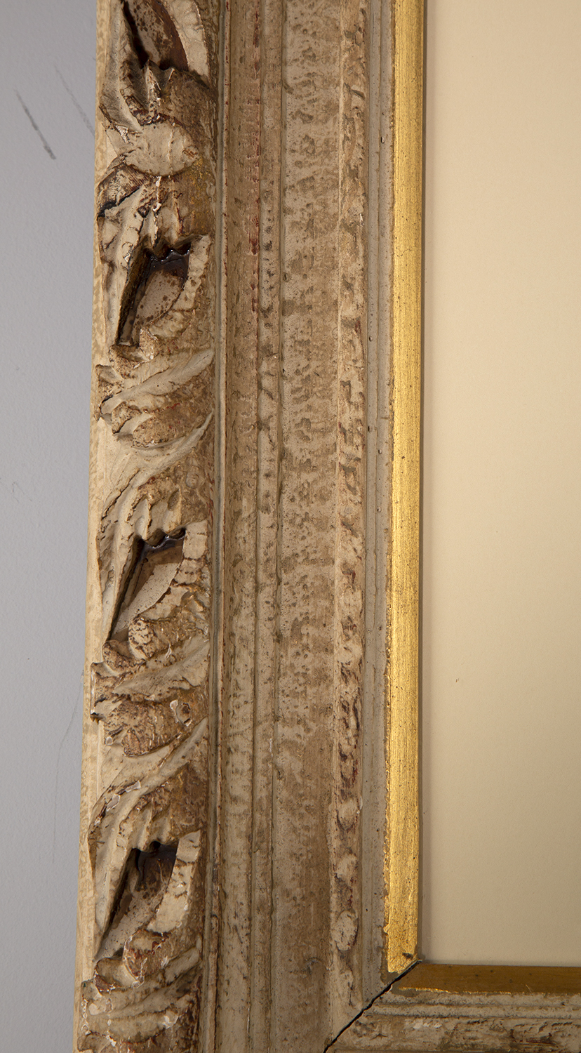 Detailed view of carved wood frame