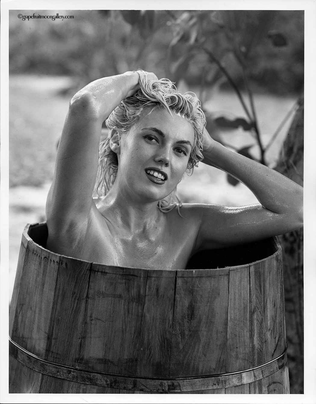 Bunny Yeager nude in barrel