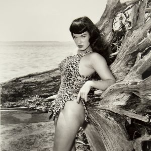 Bettie Page in cheetah print costume photographed by Bunny Yeager