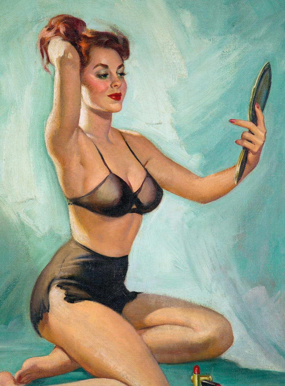 Redheaded pin-up girl wearing black undergarments, seated on the ground in front of a makeup case, and admiring her visage in a handheld mirror.