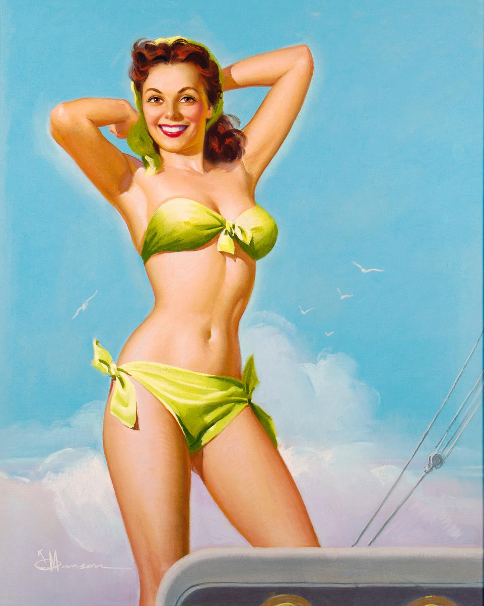 Redheaded pin-up girl in a green bikini posed on a boat against a light blue sky